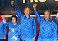 Malaysian Prime Minister Najib Razak (C), his wife Rosmah Mansor (L) and deputy Prime Minister Muhyiddin Yassin celebrate the Barisan Nasional (National Front) coalition electoral victory, on May 6, 2013 in Kuala Lumpur