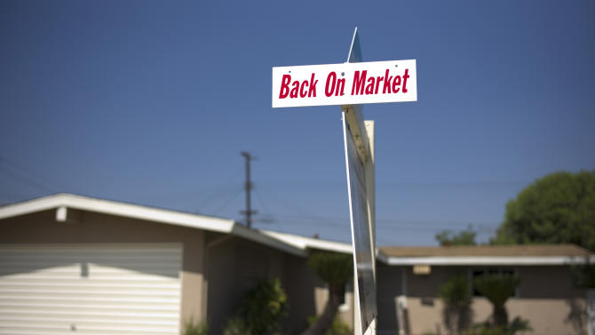This Aug. 14, 2014 photo shows a sign in front of a home for sales in Whittier, Calif. Standard & Poor's releases the S&P/Case-Shiller index of home prices for July on Tuesday, Aug. 26, 2014. (AP Photo/Jae C. Hong)