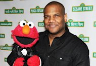 Elmo and Kevin Clash | Photo Credits: Bryan Bedder/Getty Images