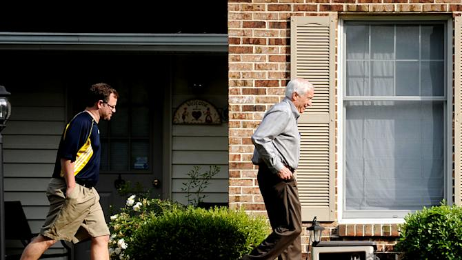 Jerry Sandusky walks to his house with Attorney Karl Rominger, Sunday, June 17, 2012, in Lemont, Pa. After four days of testimony that saw eight men from 18 to 28 years old tell jurors that Sandusky sexually abused them as children, the former Penn State assistant football coach could take the stand in his own defense at his criminal trial, but it's not certain that will happen as trial resumes on Monday. (AP Photo/Centre Daily Times,  Abby Drey)
