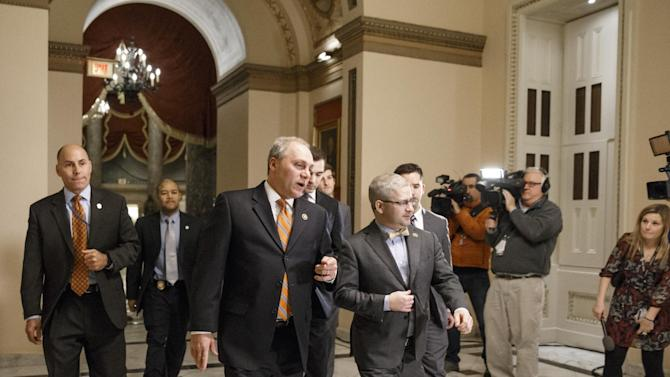 House Majority Whip Steve Scalise, R-La., center left, and  Rep. Patrick T. McHenry, R-N.C., the chief deputy whip, walk to the chamber as Congress passed a one-week bill late Friday night, Feb. 27, 2015, to avert a partial shutdown of the Homeland Security Department, as leaders in both political parties quelled a revolt by House conservatives furious that the measure left President Barack Obama's immigration policy intact, at the Capitol in Washington. (AP Photo/J. Scott Applewhite)