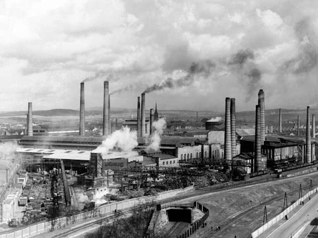 FILE - In this Aug. 29, 1938 file photo, smoke rises from smokestacks at Skodas main foundry in Pilsen, Czechoslovakia. A new study looking at 11,000 years of climate temperatures shows the world in the middle of a dramatic U-turn, lurching from near-record cooling to a heat spike. It shows how the globe for several thousands of years was cooling until an unprecedented reversal in the 20th century, which scientists say is further evidence that global warming isnt natural but man-made since the start of the Industrial Revolution. The research was released Thursday, March 7, 2013 in the journal Science. (AP Photo)