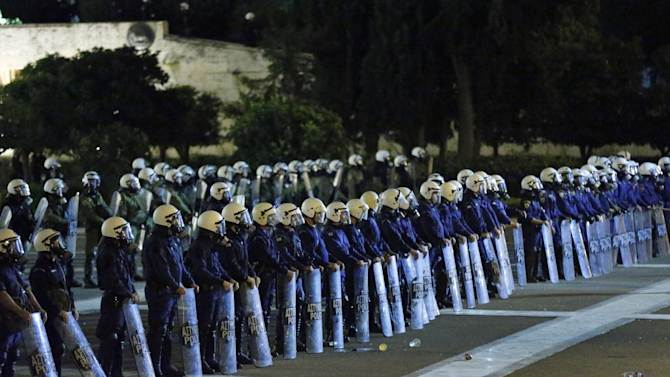 Riot police officers stand in front of the parliament during an anti-austerity demonstration in Athens, Wednesday Nov. 7, 2012. Greece's fragile coalition government faces its toughest test so far when lawmakers vote later Wednesday on new painful austerity measures demanded to keep the country afloat, on the second day of a nationwide general strike. The 13.5 billion euro ($17.3 billion) package is expected to scrape through Parliament, following a hasty one-day debate. (AP Photo/Lefteris Pitarakis)