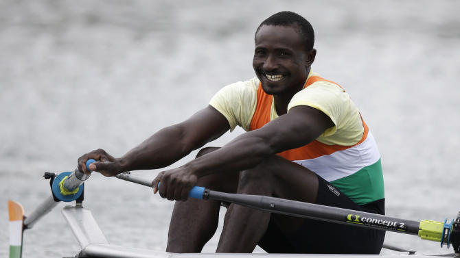 Niger's Hamadou Djibo Issaka smiles after a men's rowing single sculls semifinal in Eton Dorney, near Windsor, England, at the 2012 Summer Olympics, Tuesday, July 31, 2012. (AP Photo/Natacha Pisarenko)