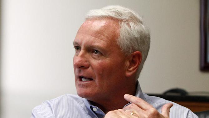 FILE - In this Friday, April 19, 2013 file photo, Jimmy Haslam, CEO of Pilot Flying J, speaks during a news conference at the company headquarters in Knoxville, Tenn. When federal agents descended on the Knoxville headquarters of Pilot Flying J on April 15, it was the first inkling the public and company executives had of an FBI and Internal Revenue Service investigation that began nearly two years ago. The privately held company with $31 billion in annual revenues is run by CEO Jimmy Haslam, who also owns the NFL's Cleveland Browns. The Haslam family, including brother Tennessee Gov. Bill Haslam, holds a majority stake. (AP Photo/Wade Payne, File)