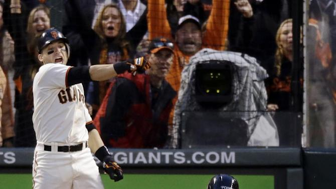 San Francisco Giants' Marco Scutaro reacts as Buster Posey (28) scores during the third inning of Game 7 of baseball's National League championship series against the St. Louis Cardinals Monday, Oct. 22, 2012, in San Francisco. (AP Photo/Mark Humphrey)