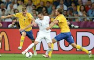 French midfielder Franck Ribery (C is challenged by Sweden&#39;s Sebastian Larsson (L) and Andreas Granqvist during their Euro 2012 match on June 19. Sweden were the side that looked to be the one who had a chance of reaching the quarter-finals rather than taking an early flight home