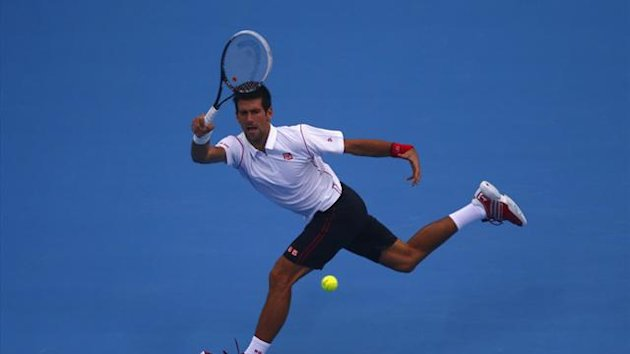 Serbia's Novak Djokovic returns a shot during his match against Lukas Rosol of the Czech Republic at the China Open tennis tournament in Beijing October 1, 2013 (Reuters)