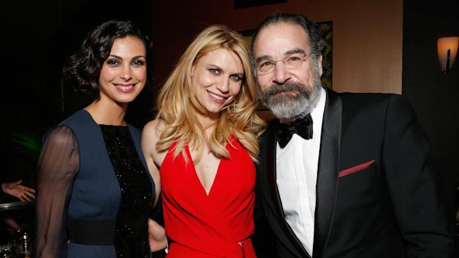 From left, Morena Baccarin, Claire Danes, and Mandy Patinkin attend the Fox Golden Globes Party on Sunday, January 13, 2013, in Beverly Hills, Calif. (Photo by Todd Williamson/Invision for Fox Searchlight/AP Images)
