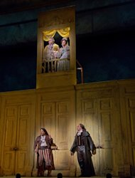 "In this Dec. 14, 2012 publicity photo, from left, Rodion Pogossov as Figaro and Alek Shrader as Count Almaviva, and balcony above, John Del Carlo as Dr. Bartolo and Isabel Leonard as Rosina are seen in Rossini's ""The Barber of Seville,"" during rehearsal at the Metropolitan Opera in New York. (AP Photo/Metropolitan Opera, Ken Howard)"