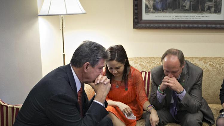 Sen. Joe Manchin, D-W.Va., left, meets in his office with families of victims of the Sandy Hook Elementary School shooting in Newtown, Conn., including Nelba Marquez-Greene, mother of victim Ana Marquez-Greene and Mark Barden, father of victim Daniel Barden, on the day he announced that he reached a bipartisan deal on expanding background checks to more gun buyers, at the Capitol in Washington, Wednesday, April 10, 2013. (AP Photo/J. Scott Applewhite)