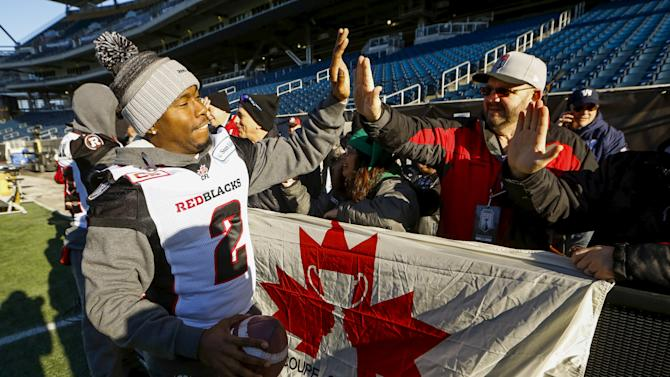 Redblacks Johnson greets fans during their team's walkthrough practice ahead of the CFL 103rd Grey Cup championship football game in Winnipeg