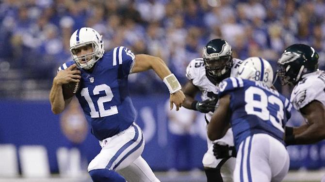 Indianapolis Colts quarterback Andrew Luck (12) runs during the second half of an NFL football game against the Philadelphia Eagles Monday, Sept. 15, 2014, in Indianapolis