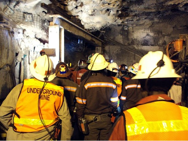 Rescue workers gather at the collapsed section of a tunnel at the Grasberg complex on May 17, 2013