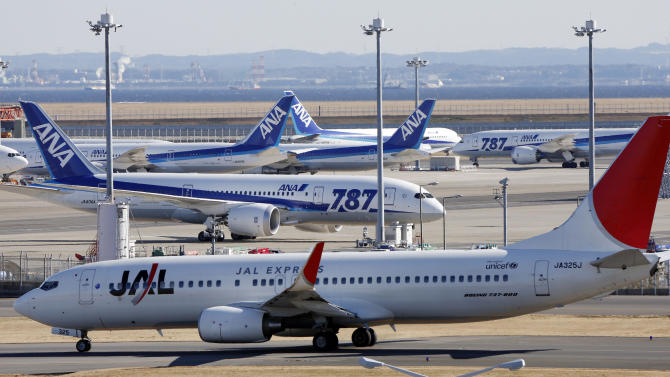 "All Nippon Airways' Boeing 787 ""the Dreamliners"" passenger jets park on the tarmac as Japan Airlines' Boeing 737 taxies by them at Haneda airport  in Tokyo, Friday, Jan. 18, 2013. U.S. safety officials and Boeing inspectors joined a Japanese investigation Friday into the 787 jet at the center of a worldwide grounding of the technologically advanced aircraft. In the wake of the incident, nearly all 50 of the 787s in use around the world have been grounded. Aviation authorities in Japan have directed ANA, which owns 17 of the planes, and Japan Airlines, with seven, not to fly the jets until questions over their safety have been resolved. (AP Photo/Koji Sasahara)"