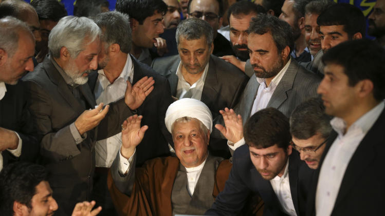 FILE -- In this Saturday, May 11, 2013 file photo, former Iranian President Akbar Hashemi Rafsanjani, 78, waves to media, as he registers his candidacy for the upcoming presidential election, at the election headquarters of the interior ministry in Tehran, Iran. Iran's election overseers say they will bar physically weak hopefuls from running in next month presidential election, a direct hint at Rafsanjani. Iran's Constitution doesn't set any age limit for presidential candidates. (AP Photo/Ebrahim Noroozi, File)