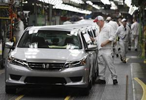 Clif Small is seen getting a 2013 Accord ready to come off the line during a tour of the Honda automobile plant in Marysville