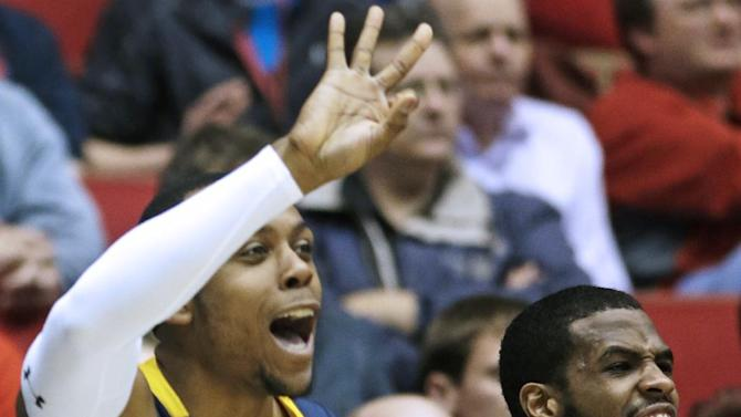 La Salle's Ramon Galloway (55) and Taylor Dunn (5) cheer from the bench after a teammate scored against Boise State in the second half of a first-round game of the NCAA college basketball tournament, Wednesday, March 20, 2013, in Dayton, Ohio. (AP Photo/Al Behrman)