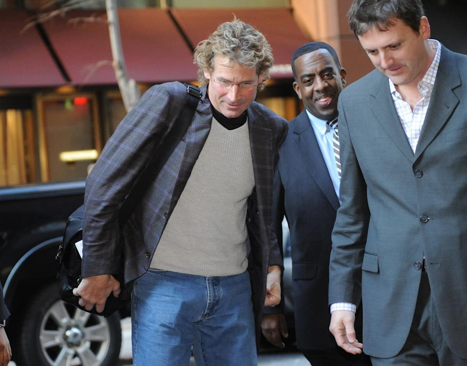 Orlando Magic President Bob Vander Weide, left, arrives at a midtown hotel where NBA labor talks are scheduled to resume, Saturday, Nov. 5, 2011, in New York. (AP Photo/ Louis Lanzano)