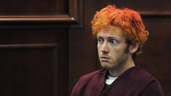 FILE - In this July 23, 2012 file photo, movie theater massacre defendant James Holmes sits during a pre-trial hearing in Arapahoe County District Court in Centennial, Colo. The courtroom where the Colorado theater shooting trial is now unfolding is awash with emotion, as survivors recount the horrors of dodging gunfire and stumbling over loved ones' maimed bodies as they fled.  (RJ Sangosti,/The Denver Post via AP, Pool)