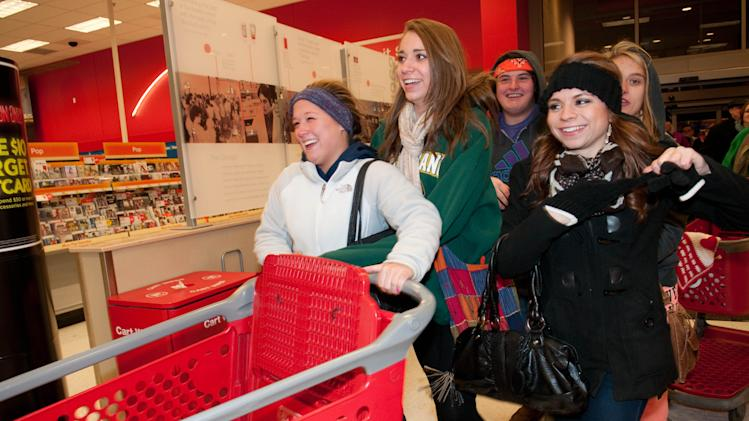 IMAGE DISTRIBUTED FOR TARGET - Shoppers eager for doorbuster deals enter the Roseville, Minn. Target store Thursday Nov. 22, 2012 for Black Friday shopping. (Dawn Villella/AP Images for Target)