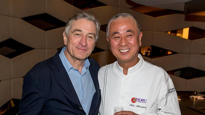 In this Feb. 2, 2013 photo provided by the Nobu Hotel, actor Robert De Niro, left, poses with his business partner, chef Nobu Matsuhisa at their new Nobu Hotel and Restaurant in Las Vegas. Japanese classically trained Matsuhisa's Nobu Hotel and Restaurant opened Saturday at Caesars Palace. (AP Photo/Nobu Hotel, Eric Kabik)