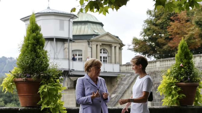 Swiss President Sommaruga and German Chancellor Merkel talk to each other in the Swiss capital Bern
