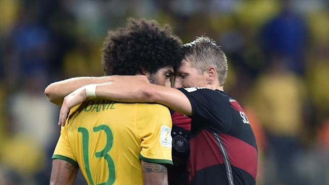 Germany's Bastian Schweinsteiger, right, consoles Brazil's Dante after the World Cup semifinal soccer match between Brazil and Germany at the Mineirao Stadium in Belo Horizonte, Brazil, Tuesday, July 8, 2014. Germany won the match 7-1