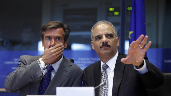 Spanish MEP Juan Fernandez Aguilar, left, looks on as United States Attorney General Eric Holder, right, speaks during a session at the European Parliament in Brussels on Tuesday, Sept. 20, 2011. Holder will participate on Tuesday in meetings with EU officials and attend a session at European Parliament. The discussions are expected to focus on data privacy and protection, transnational crime and terrorism, and enhancing U.S.-EU law enforcement, justice and security cooperation, among other issues. (AP Photo/Virginia Mayo)