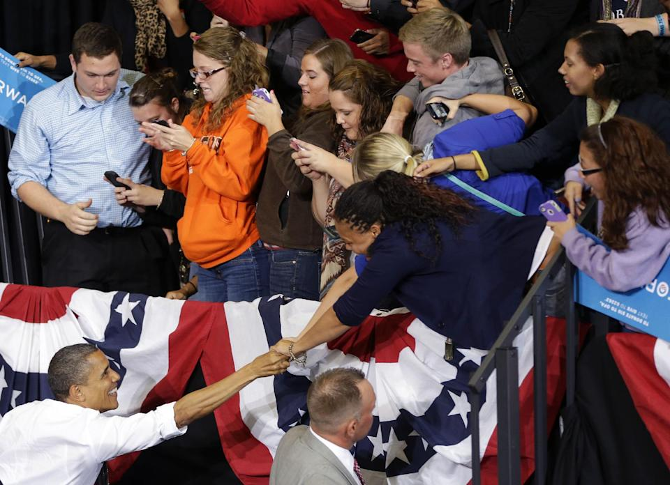 President Barack Obama reaches over to greet supporters after speaking at a campaign event at Bowling Green State University, Wednesday, Sept. 26, 2012, in Bowling Green, Ohio. (AP Photo/Pablo Martinez Monsivais)
