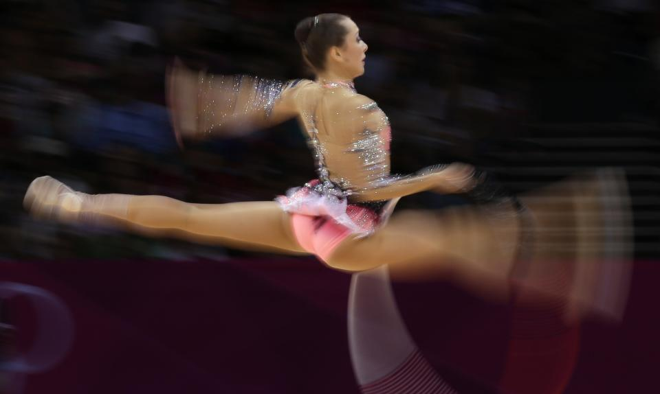 Bulgaria's Silviya Miteva performs during the rhythmic gymnastics individual all-around final at the 2012 Summer Olympics, Saturday, Aug. 11, 2012, in London. (AP Photo/Gregory Bull)