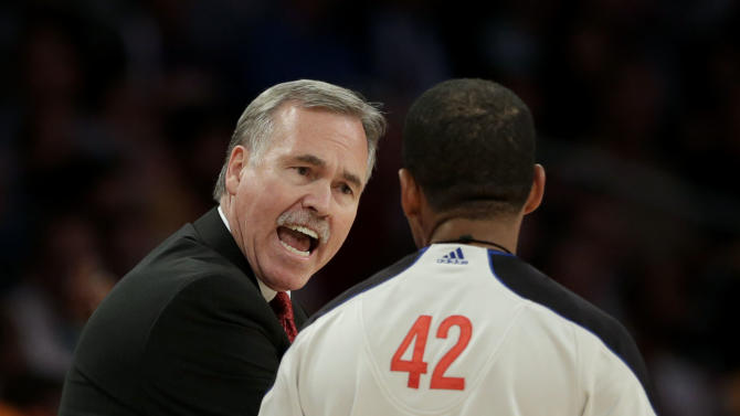 Los Angeles Lakers' Mike D'Antoni, left, argues with referee Eric Lewis after a foul call on the Lakers during the first half of an NBA basketball game against the Houston Rockets in Los Angeles, Wednesday, April 17, 2013. (AP Photo/Jae C. Hong)