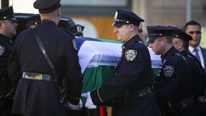The casket of Rafael Ramos arrives at Christ Tabernacle Church carried by a New York Police Department honor guard in the Queens borough of New York