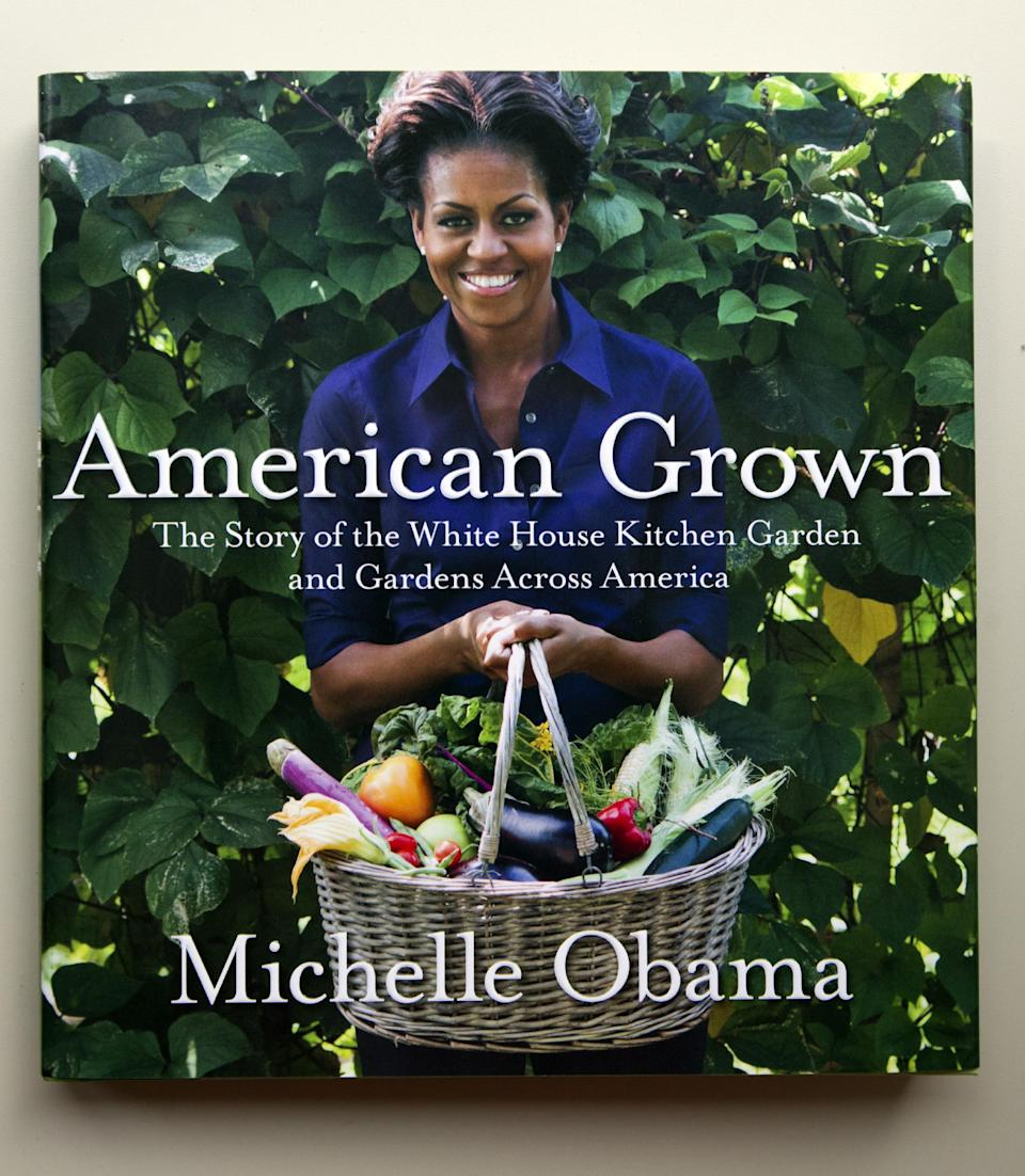 This May 24, 2012, photo shows a copy of first lady Michelle Obama's book is seen in Washington. From the beginning, Obama's kitchen garden has been an overachiever, churning out more peppers, parsley and eggplant than expected, and generating interest that _ yes, really _ crosses oceans. (AP Photo)