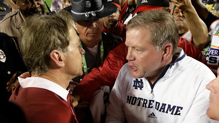 Alabama head coach Nick Saban shakes hands with Notre Dame head coach Brian Kelly after the BCS National Championship college football game Monday, Jan. 7, 2013, in Miami. Alabama won 42-14. (AP Photo/David J. Phillip)