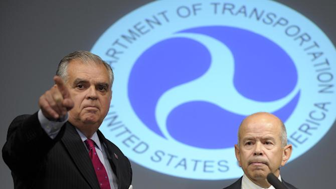 Transportation Secretary Raymond LaHood, left, and Acting Federal Aviation Administration (FAA) Administrator Michael Huerta, answer questions during a news conference at the Transportation Department in Washington, Thursday, Aug. 2, 2012. The news conference was held to answer question about three commuter jets that nearly collided at Reagan National Airport in Washington on Tuesday. (AP Photo/Susan Walsh)