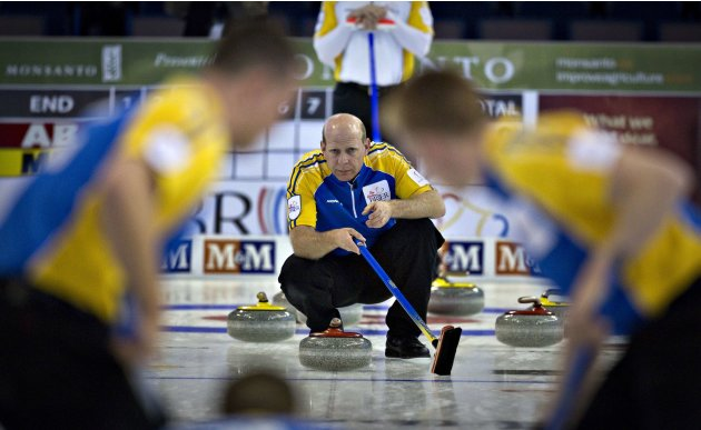 Alberta skip Martin watches the line of the rock during play against Manitoba at the Canadian Men's Curling Championships in Edmonton,