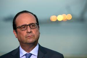 French President Francois Hollande listens to questions…
