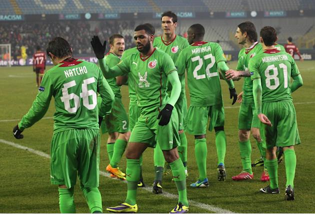 Rubin Kazan players congratulate Bebras Natcho, left, after he scored against Zulte-Waregem, during the Europa League group D soccer match at the Jan Breydel stadium in Bruges, Belgium, Thursday, Dec.