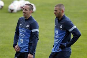 France's soccer team players Franck Ribery and Karim Benzema attend a training session at Clairefontaine, near Paris