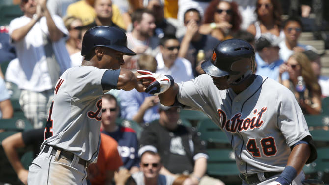 Detroit Tigers' Austin Jackson (14) celebrates with Torii Hunter (48) after the pair scored on Hunter's home run off Chicago White Sox starting pitcher Jake Peavy during the fourth inning of a baseball game Thursday, July 25, 2013, in Chicago. (AP Photo/Charles Rex Arbogast)