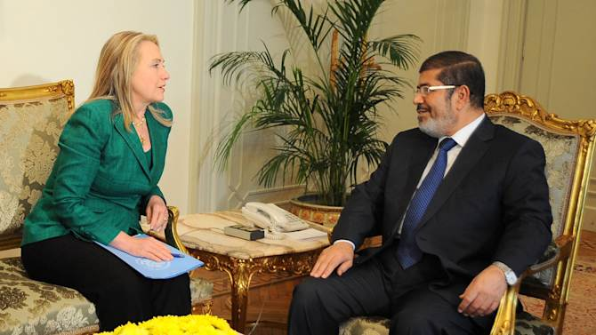 """In this photo released by the Egyptian Presidency, U.S. Secretary of State Hillary Rodham Clinton, left, meets with Egyptian President Mohammed Morsi, right, in Cairo, Egypt, Wednesday, Nov. 21, 2012. Secretary of State Hillary Rodham Clinton has arrived in Cairo in her diplomatic push to forge a truce between Israel and Gaza rulers of Hamas. Her visit comes hours after a bomb exploded on an Israeli bus in Tel Aviv, wounding several. Clinton is looking to piece together a deal to end Israel's weeklong offensive in the Gaza Strip. Clinton said the U.S. """"strongly condemns"""" today's bus bombing, calling it a """"terrorist attack."""" (AP Photo/Egyptian Presidency)"""