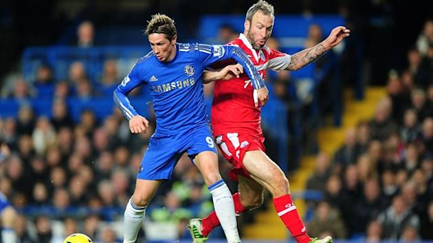 Queens Park Rangers' Shaun Derry (right) and Chelsea's Fernando Torres battle for the ball