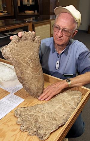 "FILE - In this Monday, June 5, 2000 file photo Al Hodgson, a volunteer guide at the Willow Creek-China Flat Musuem, holds up a plaster cast of a Bigfoot imprint displayed at the museum's new ""Bigfoot Wing"" in Willow Creek, Calif. European researchers are planning to use new techniques to analyze DNA that could help crack the mystery of whether Bigfoot exists. In a project announced this week, May 2012, Oxford University and Lausanne Museum of Zoology scientists appealed to museums, scientists and yeti aficionados to share samples thought to be from the mythical ape-like creature. Researchers plan to focus on hair samples to determine the species it originated from. New genetic tests will be done on just a few strands, and completed within weeks. (AP Photo/Rich Pedroncelli, file)"