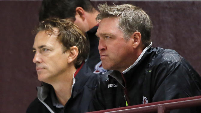 Colorado Avalanche general manager Joe Sakic, left, and head coach Patrick Roy watch players during the first day of  NHL hockey training camp Thursday, Sept. 19, 2014, in Centennial, Colo. (AP Photo/Jack Dempsey)