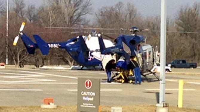 This image from video provided by KMOV-TV in St. Louis shows an injured worker is helped into a helicopter outside the American Steel plant in Granite City, Ill., Thursday, March 7, 2013, where an explosion injured at least 10 people, three critically. (AP Photo/Courtesy KMOV-TV in St. Louis) TELEVISION OUT
