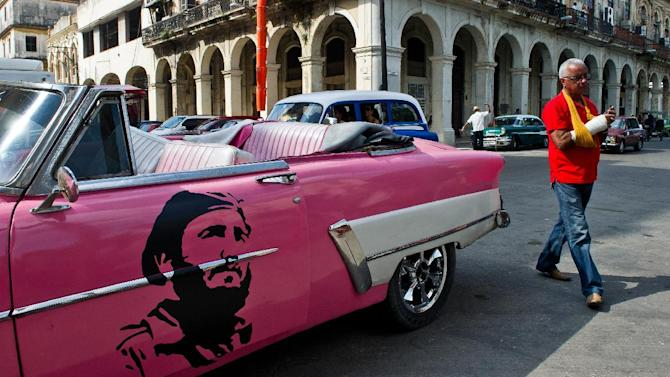 An old American car with an image of former Cuban president Fidel Castro on the door is seen in a street of Havana, on January 19, 2015