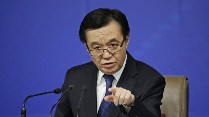 China's Minister of Commerce Gao Hucheng answers a question at a news conference in Beijing