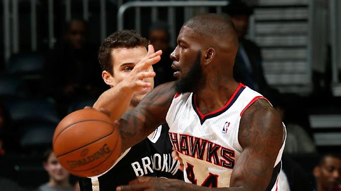 Ivan Johnson (R) played with the Atlanta Hawks from 2011-2013