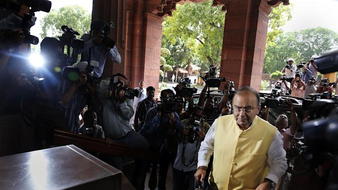 Indian Finance Minister Arun Jaitley arrives to present the 2014-15 union budget at the Indian parliament in New Delhi, Thursday, July 10, 2014. India's new government has introduced an ambitious reform-minded budget focusing on promoting manufacturing and infrastructure, raising the tax base and overhauling populist subsidies. (AP Photo/Manish Swarup)